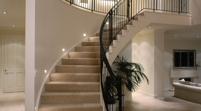 View of the stairway baluster, floor, flooring, handrail, interior design, lobby, stairs, brown, gray