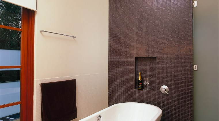 The view of a bathroom featuring a bath bathroom, ceiling, floor, flooring, home, interior design, plumbing fixture, property, real estate, room, tile, wall, gray