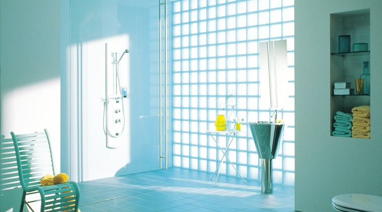 The view of a bathroom showing glass blocks azure, bathroom, blue, curtain, daylighting, door, floor, glass, home, interior design, room, tile, wall, window, window blind, window covering, window treatment, teal, white