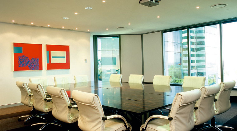 A boardroom with table, chairs and view of ceiling, conference hall, furniture, interior design, office, table, orange