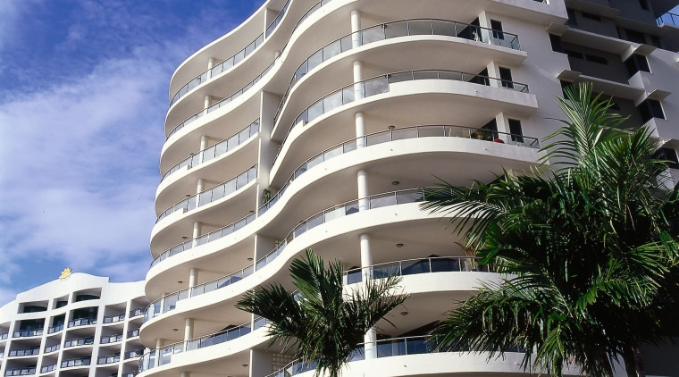 Exterior of eleven storey apartment building on the apartment, architecture, arecales, building, commercial building, condominium, corporate headquarters, daytime, estate, facade, headquarters, hotel, metropolis, metropolitan area, mixed use, palm tree, property, real estate, residential area, sky, tower block, window, gray