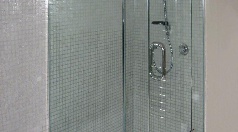 The detail of a shower bathroom, glass, plumbing fixture, shower, shower door, tile, gray