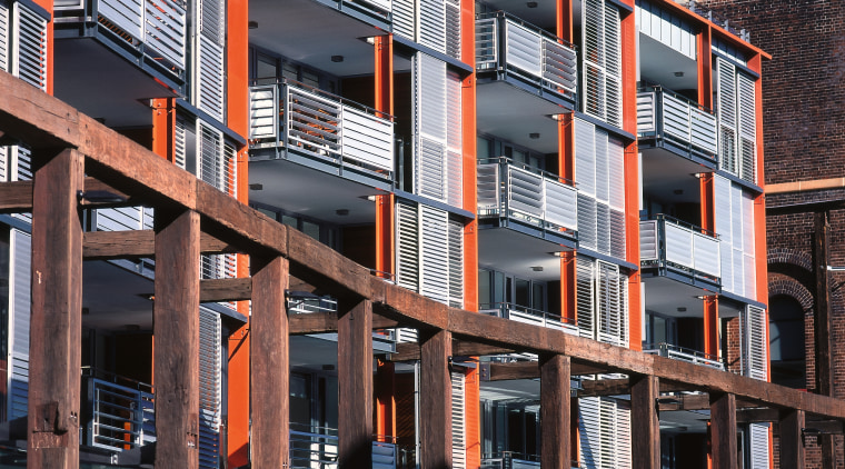 Large timber warehouses have been converted into apartments. apartment, architecture, balcony, building, city, condominium, facade, house, metropolis, mixed use, neighbourhood, real estate, residential area, urban area, window, black