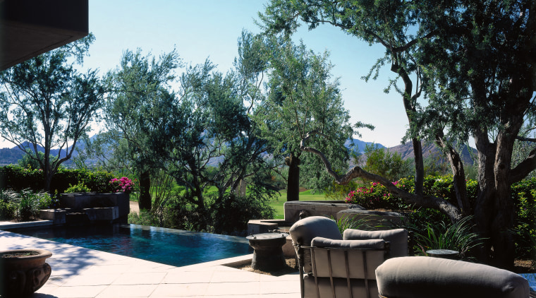 View of the outdoor living area arecales, backyard, estate, home, house, landscape, landscaping, leisure, outdoor structure, palm tree, patio, plant, property, real estate, resort, swimming pool, tree, villa, water, yard, black, white