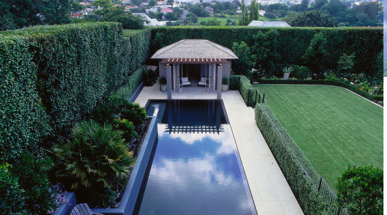 The pool adjoins a large flat lawn. architecture, cloud, estate, grass, house, landscape, property, real estate, reflecting pool, roof, sky, swimming pool, water, water feature, water resources, blue