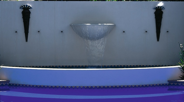 Close up view of fountain by swimming pool blue, light, lighting, majorelle blue, reflection, swimming pool, water, blue