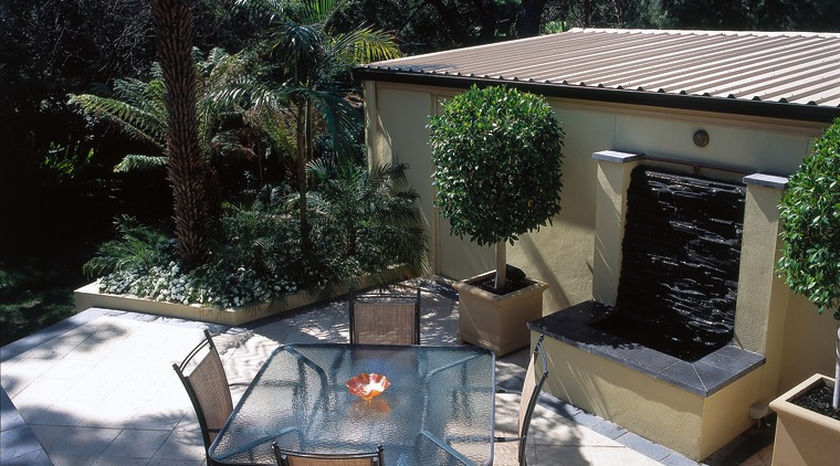 View of this outdoor living area backyard, courtyard, outdoor furniture, outdoor structure, patio, property, table, yard, black