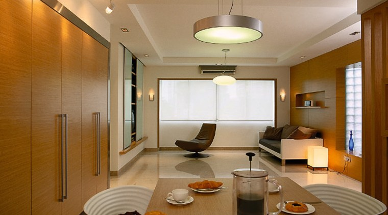The living area & table ceiling, floor, interior design, lighting, living room, real estate, room, brown, orange