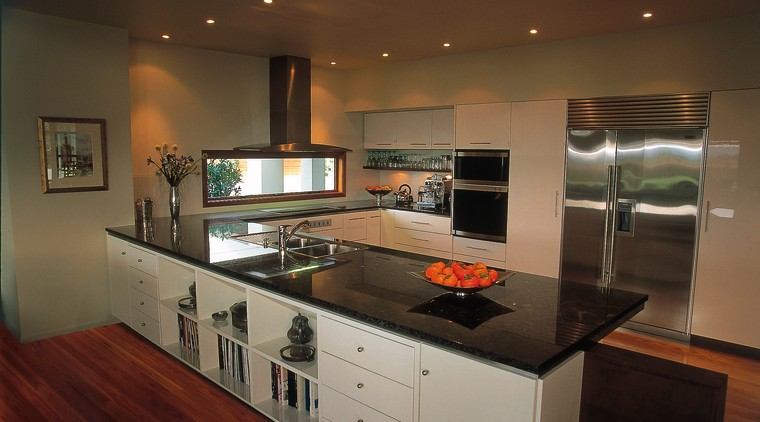 An example of a kitchen designed, manufactured and cabinetry, countertop, interior design, kitchen, room, brown