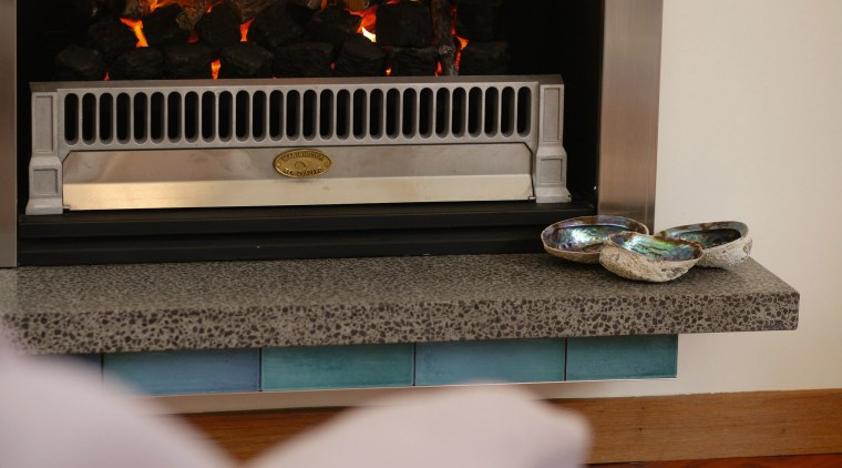 Gas fire with stainless steel surround, and stone fireplace, hearth, gray