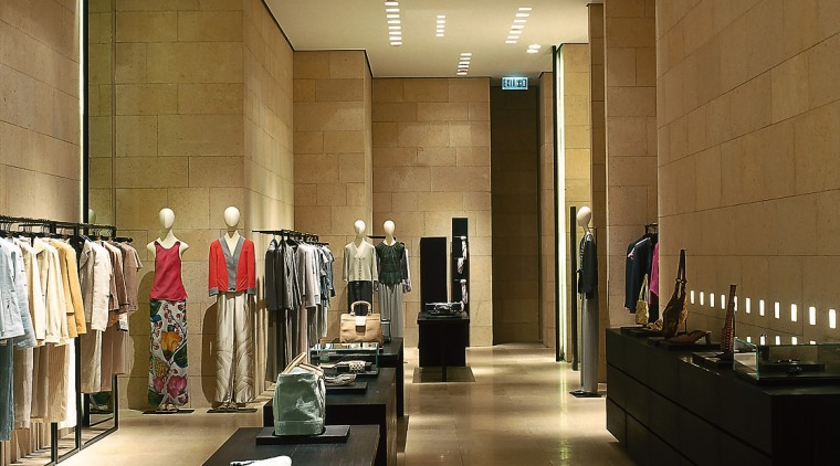 This boutique is clad in French St Maximin ceiling, floor, flooring, furniture, interior design, lobby, brown