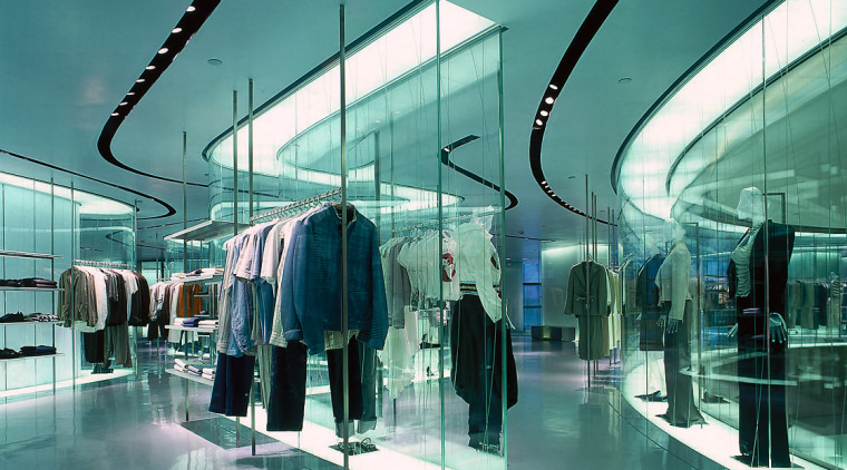 Mannequins are translucent to focus attention on the architecture, building, glass, interior design, shopping mall, teal
