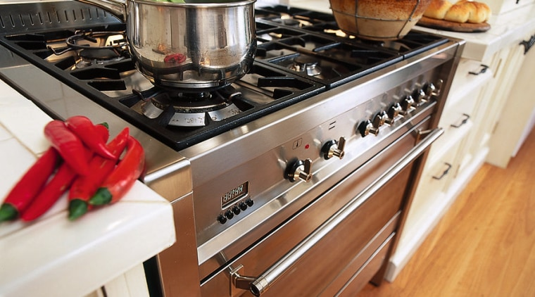 Inner view of the oven & cooktop cookware and bakeware, countertop, gas stove, kitchen, kitchen appliance, kitchen stove, white