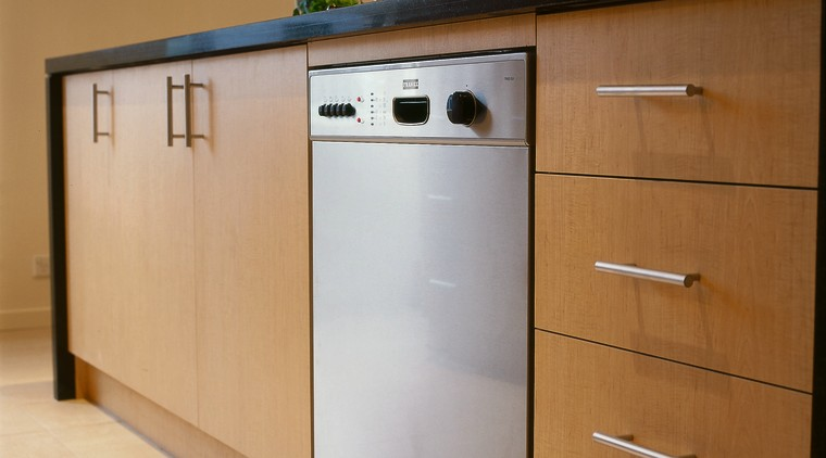 Close-up view of the dishwasher & cabinetry cabinetry, chest of drawers, drawer, furniture, sideboard, brown, orange