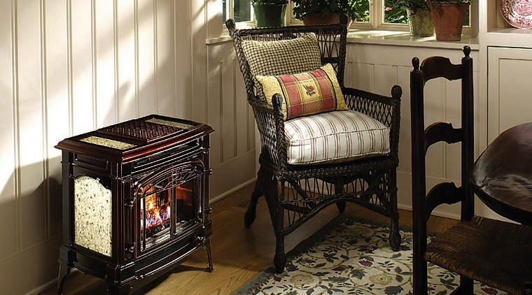 View of a traditional style fireplace chair, floor, flooring, furniture, home, interior design, living room, product, room, table, black, brown