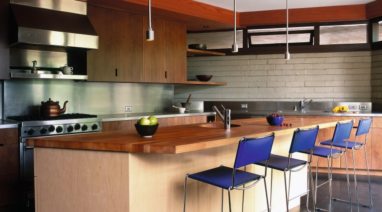 Kitchen with walnut cabinetry, polished concrete floors, modern cabinetry, countertop, interior design, kitchen
