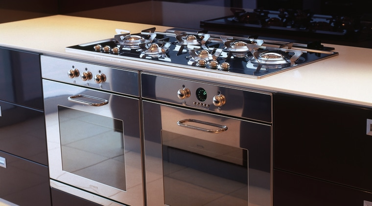 Kitchen with stainless steel ovens and gas hob. countertop, gas stove, home appliance, kitchen, kitchen appliance, kitchen stove, major appliance, black