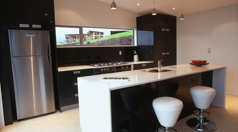 Kitchen with black and white cabinetry, gas cooktop, countertop, interior design, kitchen, real estate, black