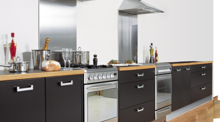 Kitchen showing freestanding gas oven and electric oven cabinetry, countertop, cuisine classique, home appliance, interior design, kitchen, kitchen appliance, kitchen stove, white, black