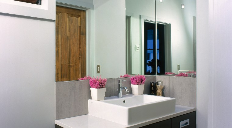 The view of an ensuite with a cantilevered bathroom, bathroom accessory, bathroom cabinet, countertop, interior design, product design, room, sink, gray