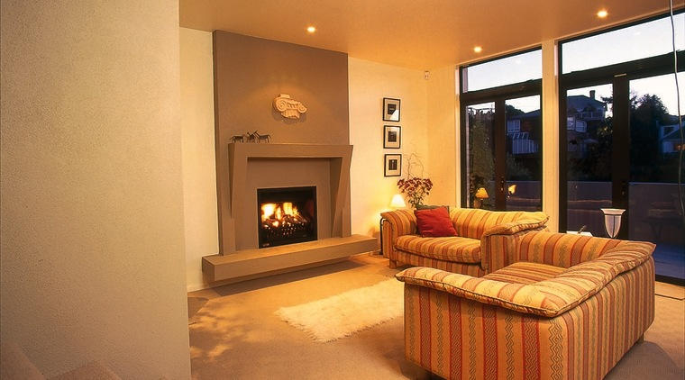 Lounge room with fire set into concrete surround, ceiling, fireplace, floor, flooring, hearth, home, interior design, living room, property, real estate, room, orange, brown