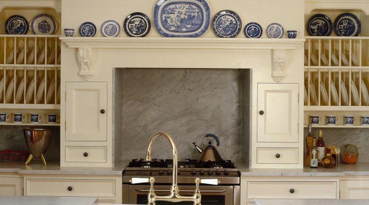 Inner view of the cooktop & benchtop fireplace, furniture, hearth, interior design, wall, orange, brown