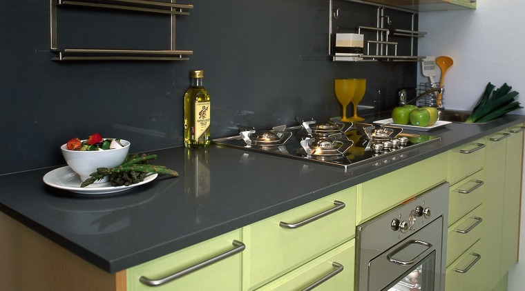 A kitchen with a colourful style cabinetry, countertop, cuisine classique, home appliance, interior design, kitchen, kitchen appliance, kitchen stove, major appliance, room