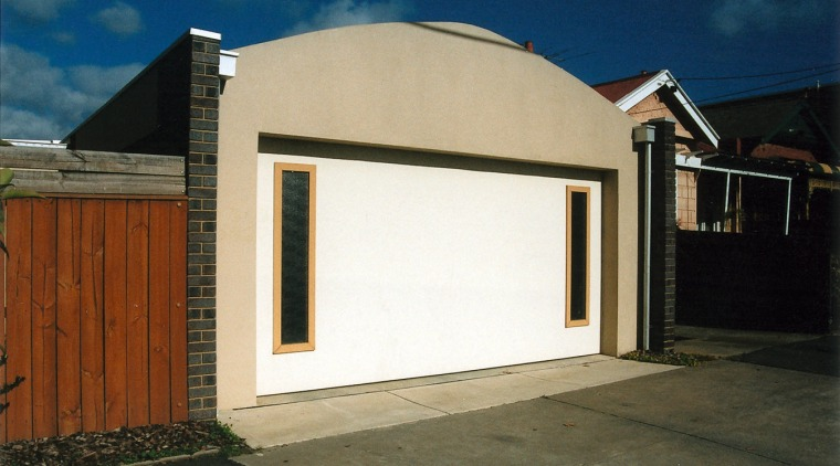 Large white garage door with yellow and black building, door, facade, garage, garage door, home, house, property, real estate, shed, window