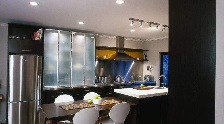 Kitchen with stainless steel benchtops and splashbacks, rangehood, ceiling, countertop, dining room, interior design, kitchen, real estate, room, table, gray, black
