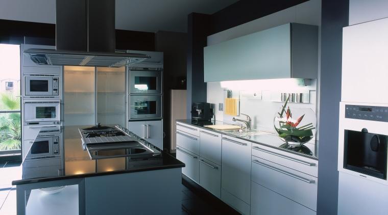 View of this contemporary kitchen countertop, cuisine classique, home appliance, interior design, kitchen, kitchen appliance, black, gray