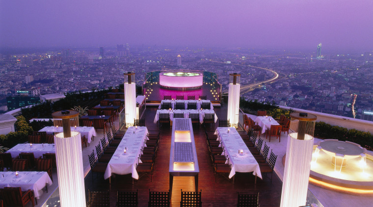 View of the rooftop diner architecture, city, landmark, night, sky, structure, purple