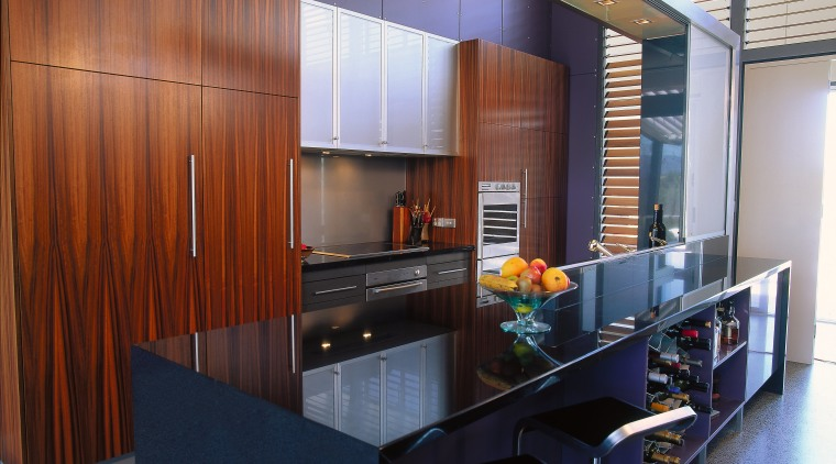The view of a contemporary kitchen with purple countertop, interior design, kitchen, real estate