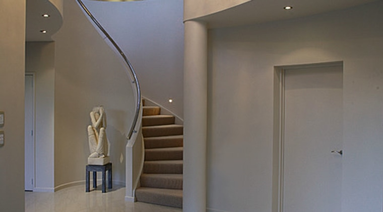 A overview of the curved staircase whch leads apartment, architecture, ceiling, daylighting, estate, floor, flooring, home, house, interior design, lobby, real estate, stairs, tourist attraction, wall, window, gray