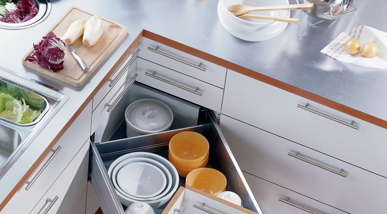 Light coloured kitchen cabinets showing corner drawer storage countertop, furniture, kitchen, product, product design, small appliance, table, gray