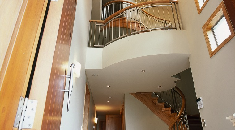 The staircase of this large home architecture, ceiling, daylighting, estate, handrail, home, interior design, lobby, property, real estate, stairs, structure, orange, brown