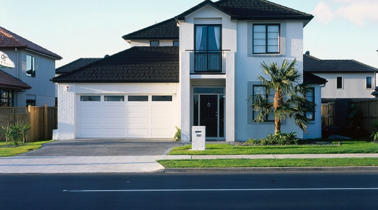 Frontal view of this double-storey home architecture, asphalt, building, elevation, estate, facade, home, house, neighbourhood, property, real estate, residential area, roof, siding, sky, suburb, blue