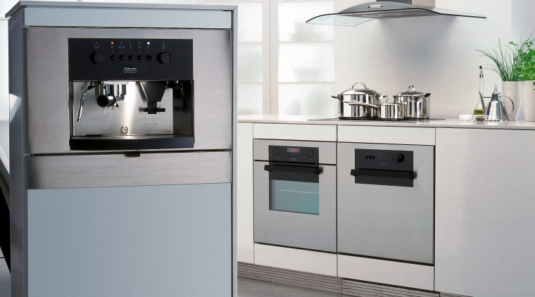 A photograph of a European styled kitchen. The gas stove, home appliance, kitchen, kitchen appliance, kitchen stove, major appliance, oven, product, product design, refrigerator, small appliance, gray, white