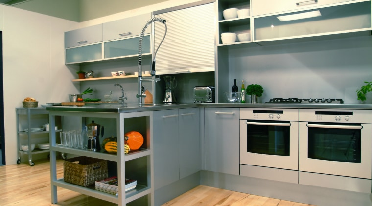 A semi-industrial looking kitchen featuring the latest Bosch countertop, home appliance, interior design, kitchen, orange, gray