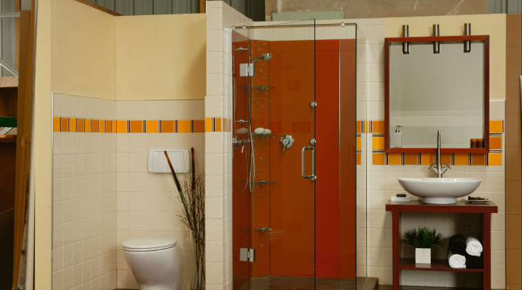 A bathroom featuring an orange coloured glass shower. bathroom, bathroom accessory, floor, interior design, plumbing fixture, room, toilet, brown, orange