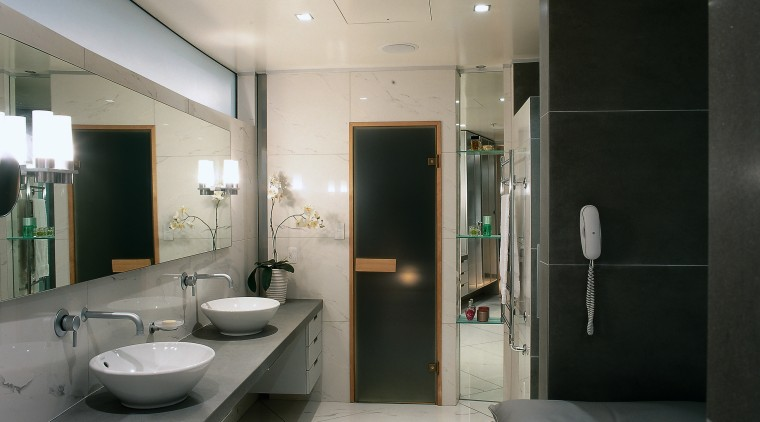 view of bathroom showing large cream tiles and architecture, bathroom, interior design, real estate, room, gray, black