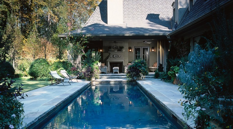 View of the pool area architecture, backyard, cottage, estate, home, house, landscaping, mansion, outdoor structure, property, real estate, reflection, swimming pool, villa, water, black, teal