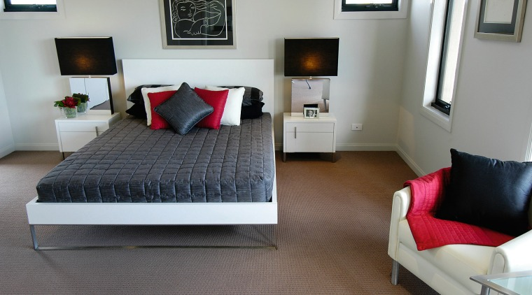 The bedroom of this home bed, bed frame, bedroom, floor, flooring, furniture, home, interior design, room, suite, gray