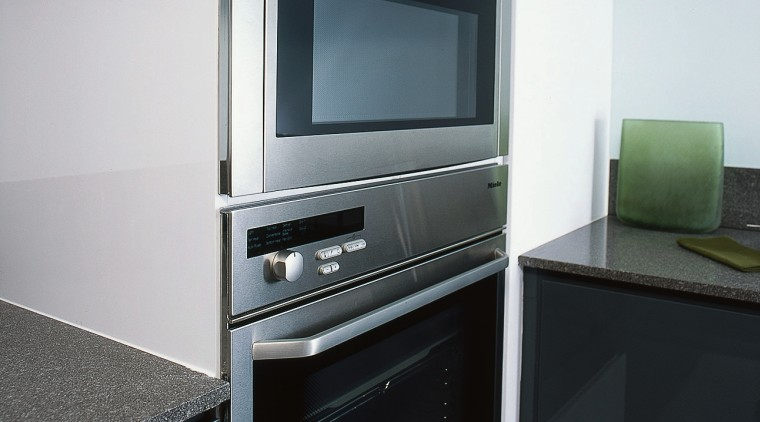 View of these ovens  on the wall home appliance, kitchen, kitchen appliance, major appliance, microwave oven, product design, gray, black