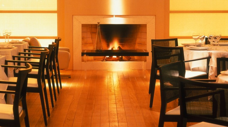 View of the dining area fireplace, floor, flooring, furniture, hearth, interior design, table, wood, brown