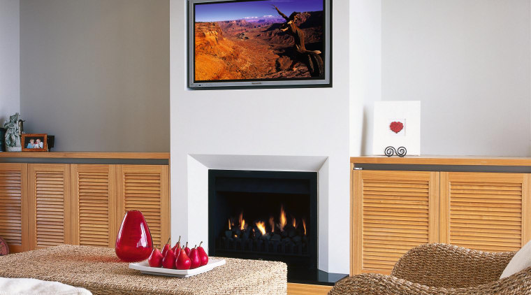 A fireplace with a plasma televsion above it. fireplace, hearth, home, interior design, living room, room, wall, gray