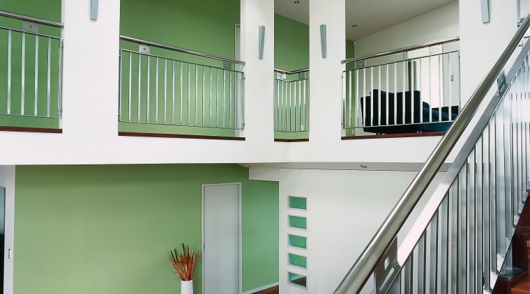 A view of the feature wall painted with architecture, balcony, baluster, daylighting, estate, floor, handrail, home, house, interior design, real estate, stairs, window, gray