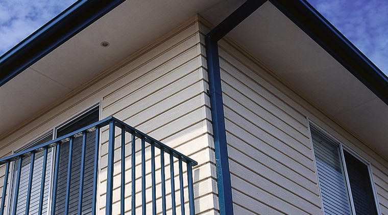 View of the side of this home architecture, balcony, building, commercial building, daylighting, daytime, facade, home, house, line, real estate, residential area, roof, siding, sky, structure, window, blue, gray