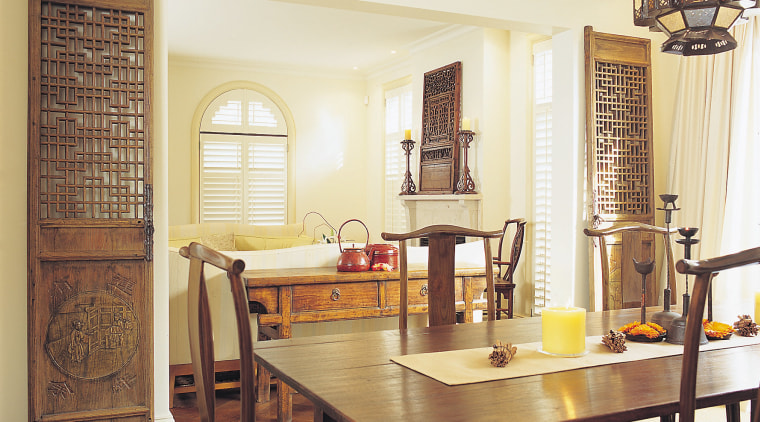A photograph of an eastern styled dining dining room, furniture, home, interior design, living room, real estate, room, table, window, yellow