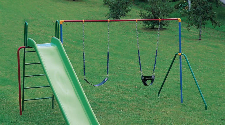 Outdoor play equipment with green slide, and two chute, grass, outdoor play equipment, playground, playground slide, public space, swing, green