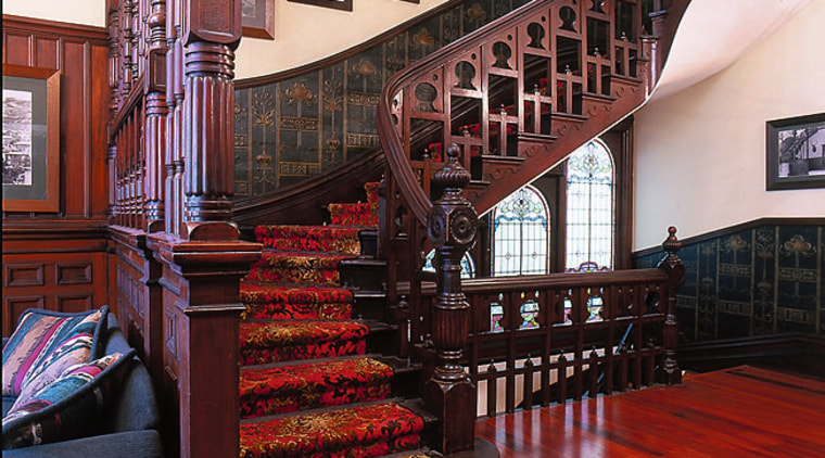 View of staircase in this house architecture, building, flooring, interior design, stairs, wood, red, black